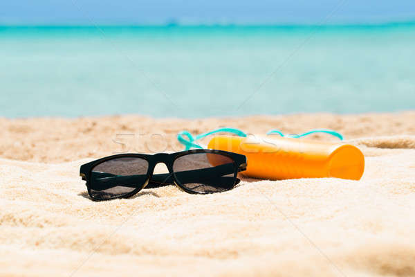 Sunglasses, Sunscreen Lotion And Slippers On The Beach Stock photo © AndreyPopov