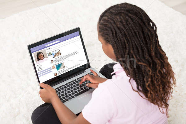 Girl Browsing Social Site On Laptop Stock photo © AndreyPopov