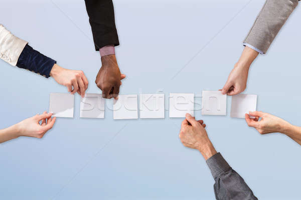Businesspeople Arranging White Paper Stock photo © AndreyPopov