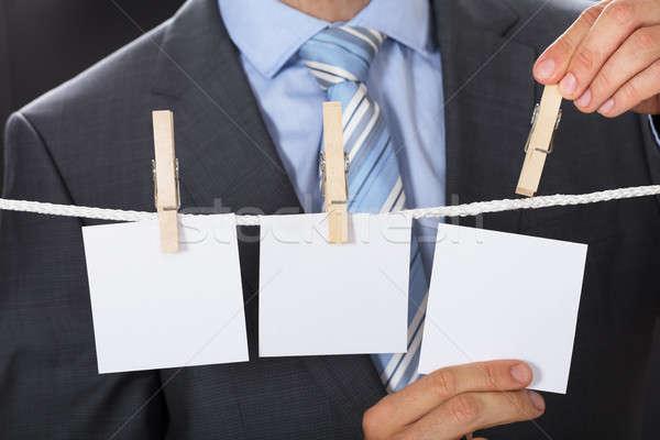 Zakenman blanco papier waslijn business man Stockfoto © AndreyPopov