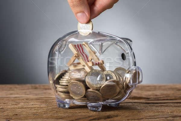 Mano moneda transparente alcancía cubierta silla Foto stock © AndreyPopov