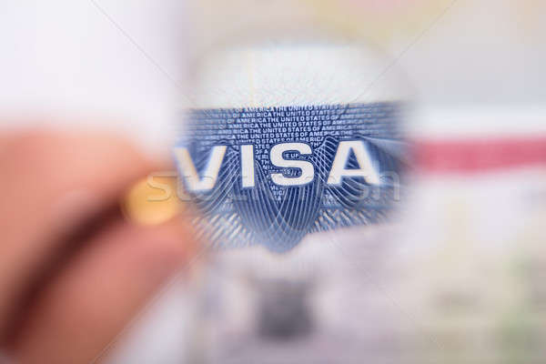 Human Hand Zooming At Visa Text Stock photo © AndreyPopov