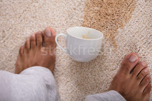 Person's Feet Standing Near Spilled Coffee Stock photo © AndreyPopov