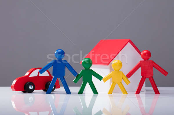 Human Figures, House Model And Car On Desk Stock photo © AndreyPopov