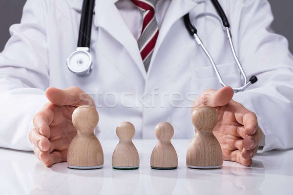 Doctor Protecting Family Stock photo © AndreyPopov