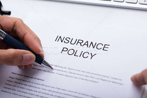 Person Filling Insurance Policy Form Stock photo © AndreyPopov