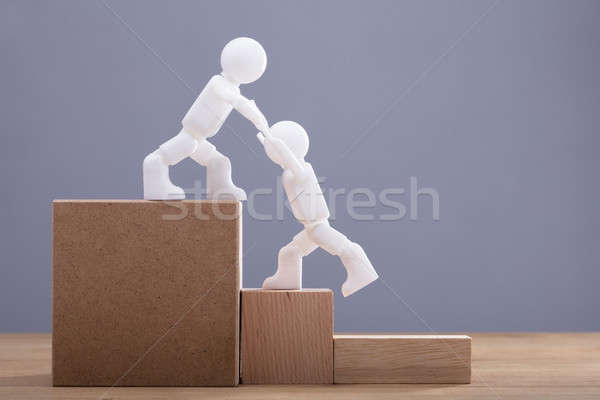 Human Figure Helping Colleague While Climbing Staircase Stock photo © AndreyPopov