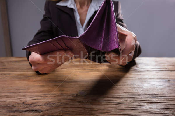 Businessperson Holding Empty Purse Stock photo © AndreyPopov