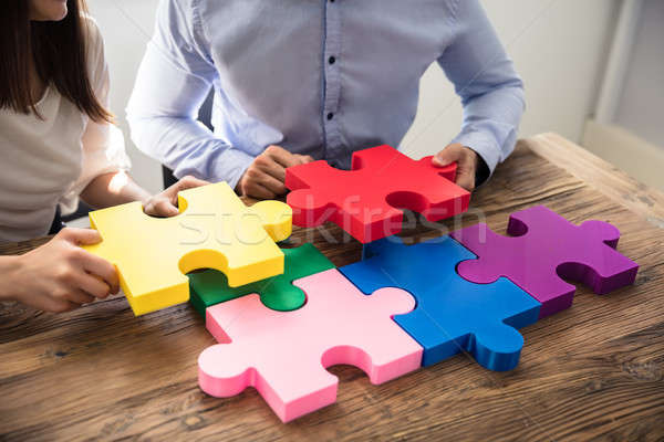 Two Businesspeople Solving Jigsaw Puzzle Stock photo © AndreyPopov