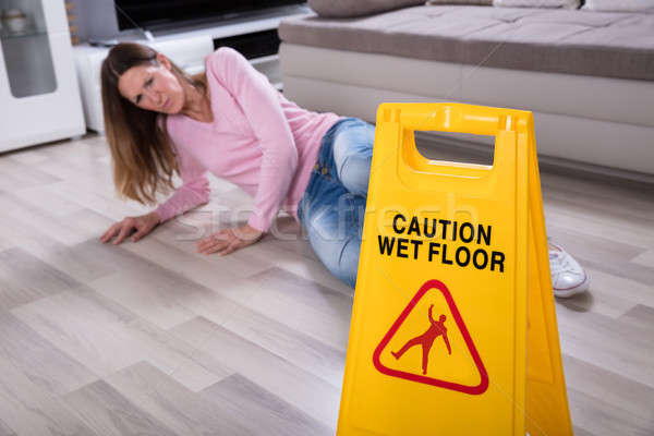 Woman Falling Near Caution Sign At Home Stock photo © AndreyPopov