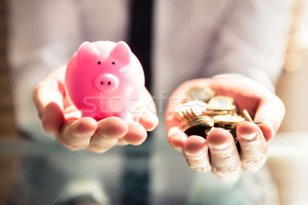 Businessperson Holding Piggybank And Golden Coins Stock photo © AndreyPopov