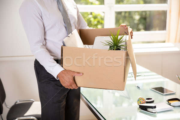 Businessman Holding Belongings In Cardboard Box Stock photo © AndreyPopov