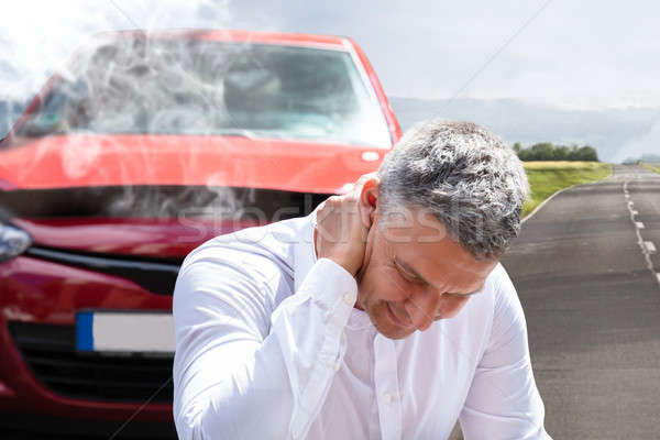 Man Suffering From Neck Pain In Front Of Breakdown Car Stock photo © AndreyPopov