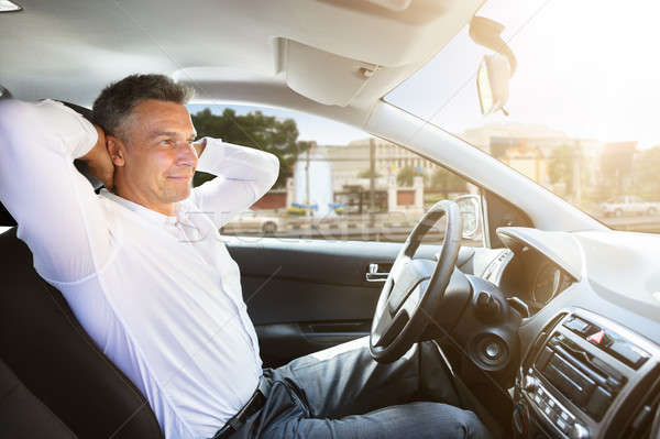 Relaxed Man Sitting In Self Driving Car Stock photo © AndreyPopov