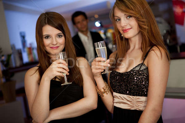 Two young women drinking chanpagne Stock photo © AndreyPopov