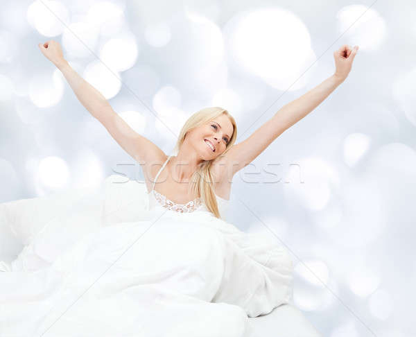 Young happy smiling woman waking up Stock photo © AndreyPopov