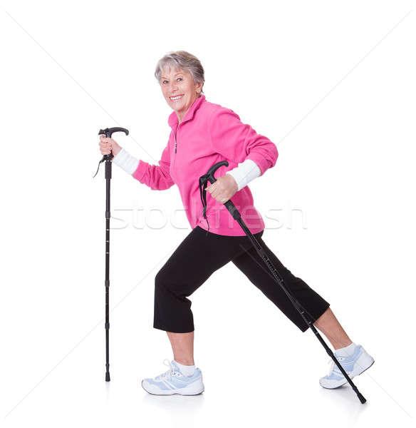 Senior Frau Fuß Wandern weiße Hintergründe glücklich Stock foto © AndreyPopov