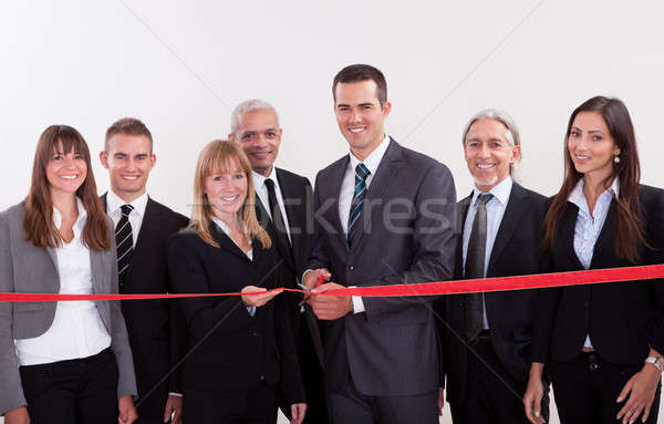 Management about to cut the red ribbon Stock photo © AndreyPopov