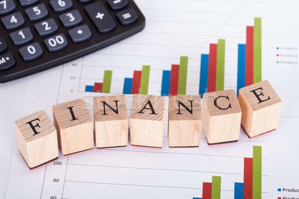 Pénzügy statisztika fakockák levelek oldal grafikonok Stock fotó © AndreyPopov