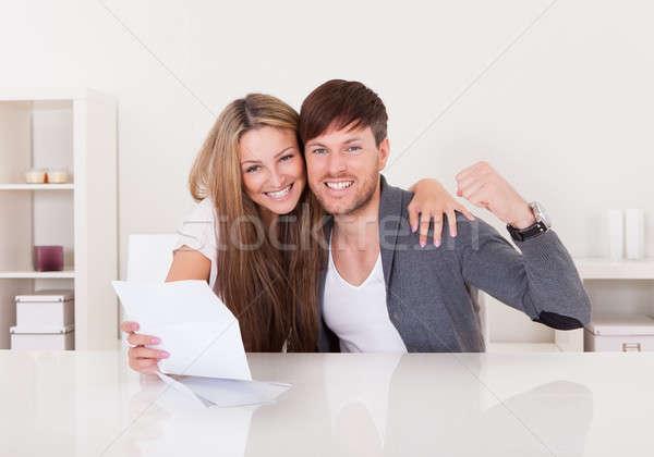 Casal uma boa notícia feliz notícia menino trabalho Foto stock © AndreyPopov