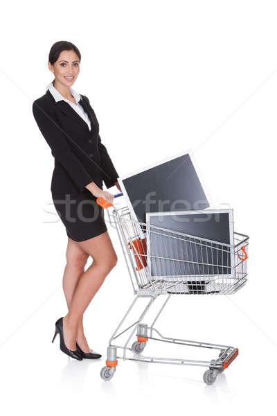 Atractivo mujer de negocios compras LCD aislado blanco Foto stock © AndreyPopov