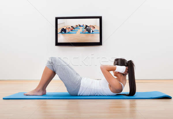Athletic woman working out at home Stock photo © AndreyPopov