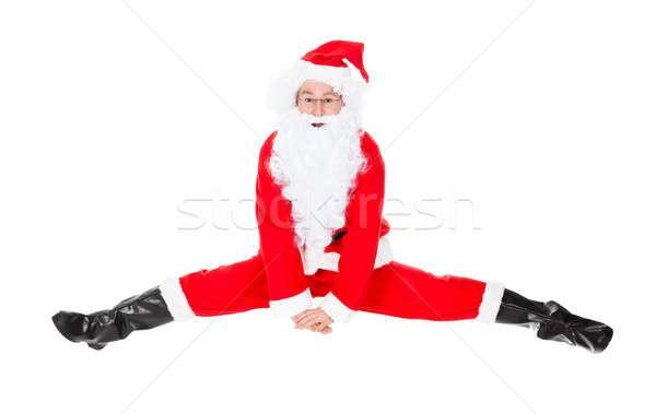 Santa Claus Sits On A Splits Stock photo © AndreyPopov