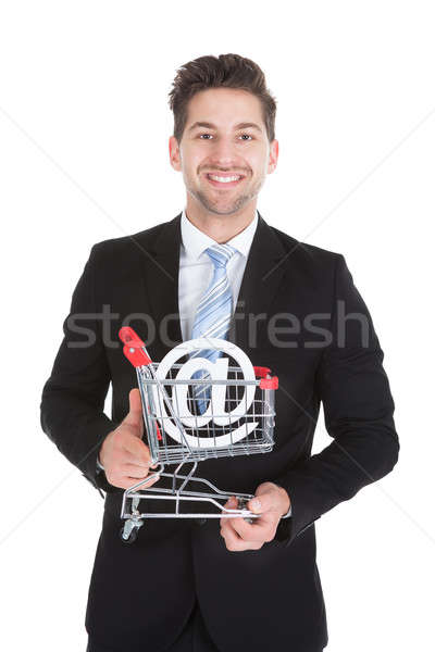 Businessman With Pushcart And Internet Symbol Stock photo © AndreyPopov