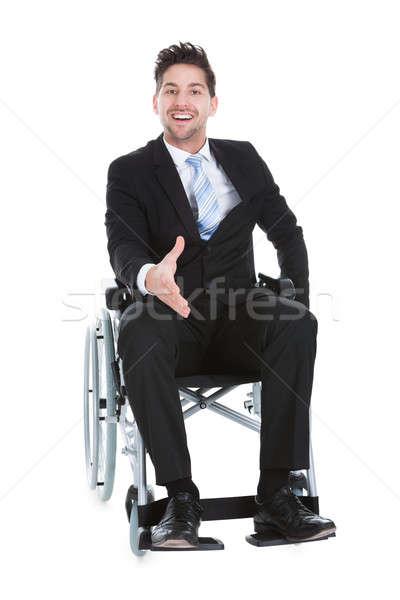 Businessman On Wheelchair Offering Handshake Stock photo © AndreyPopov