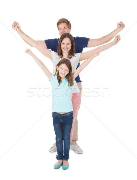 Boldog család karok a magasban áll vonal teljes alakos portré Stock fotó © AndreyPopov