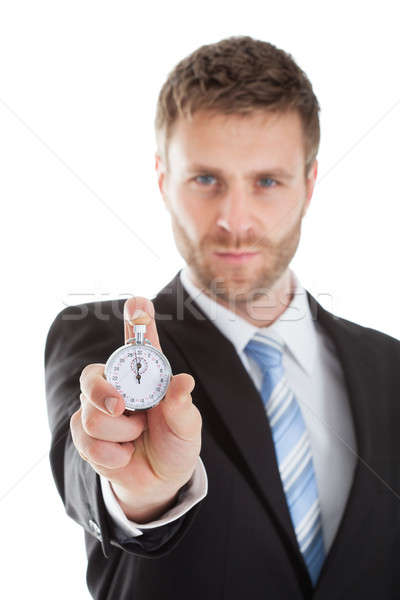 Confident Businessman Showing Stopwatch Stock photo © AndreyPopov