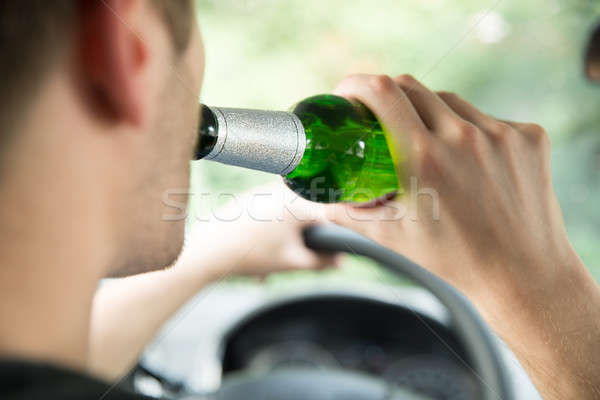 Man Drinking Alcohol While Driving Car Stock photo © AndreyPopov