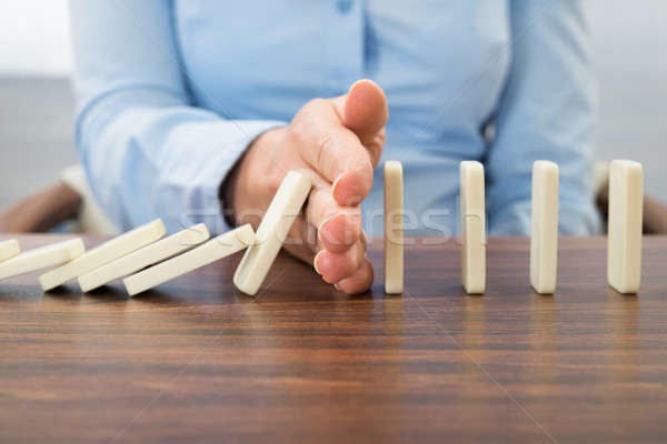 Businesswoman Stopping The Effect Of Domino Stock photo © AndreyPopov
