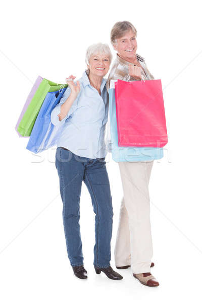 Senior Couple Carrying Shopping Bag Stock photo © AndreyPopov