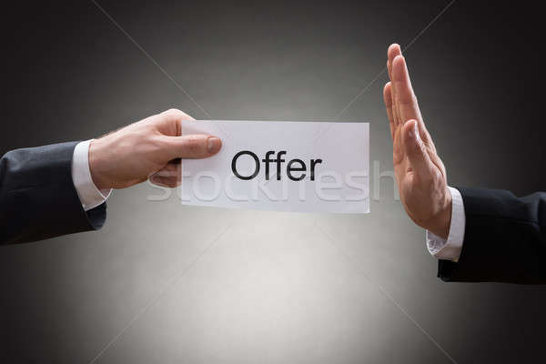 Close-up Of Two Hand's Holding Offer Paper Stock photo © AndreyPopov