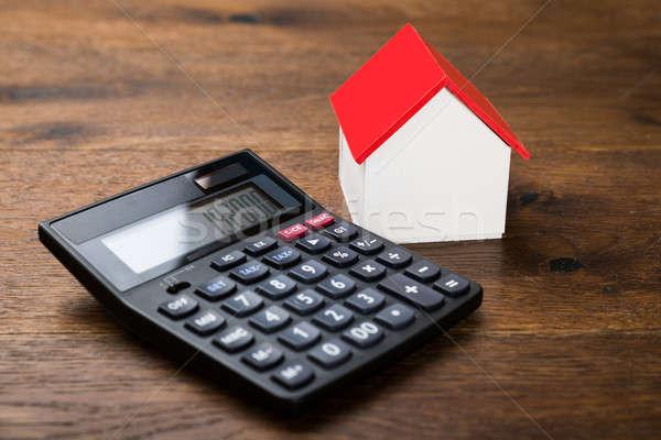 Miniatűr ház számológép közelkép fa asztal üzlet Stock fotó © AndreyPopov