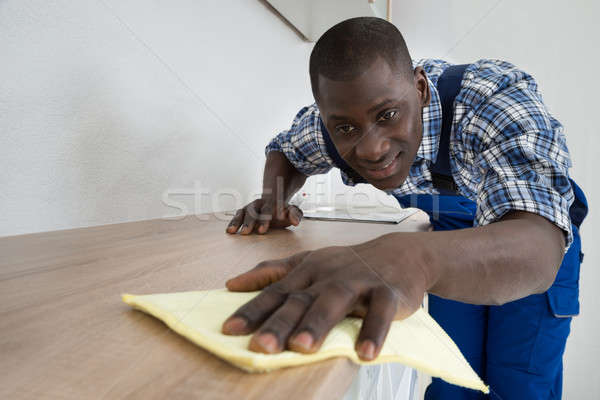 Janitor Cleaning Kitchen Worktop Stock photo © AndreyPopov