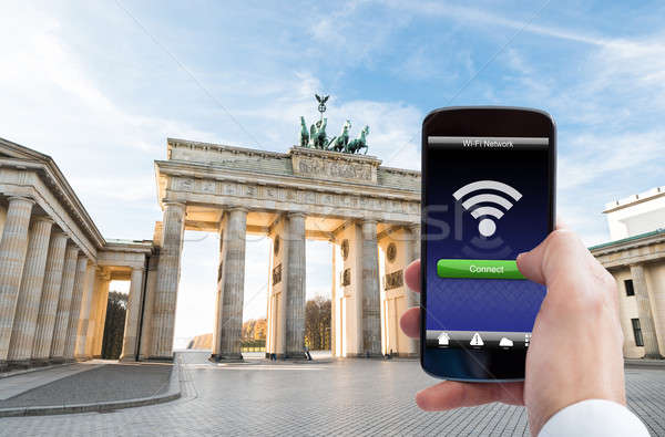 Person Hand With Mobile Phone At Brandenburg Gate Stock photo © AndreyPopov