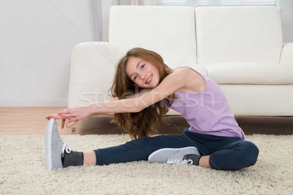 Happy Girl Doing Workout Stock photo © AndreyPopov