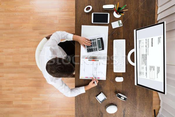 Male Accountant Checking Invoice Stock photo © AndreyPopov