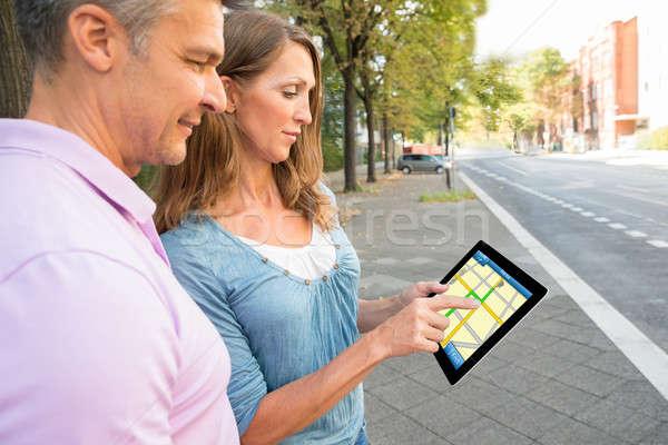 Casal olhando gps mapa feliz digital Foto stock © AndreyPopov