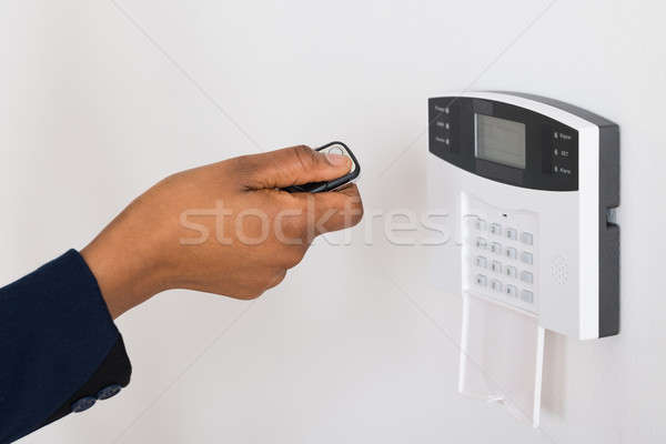 Person's Hand Operating Entrance Security System With Remote Stock photo © AndreyPopov