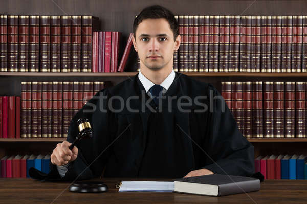 Portrait Of Confident Judge Hitting Mallet At Desk Stock photo © AndreyPopov