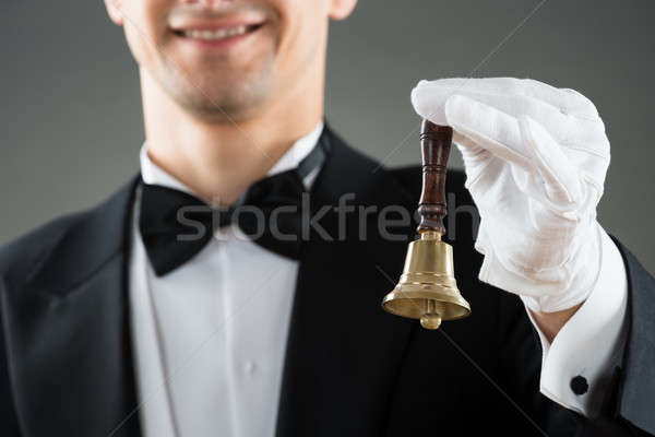 Midsection Of Waiter Holding Ring Bell Stock photo © AndreyPopov