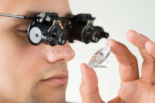 Jeweler Examining Diamond With Magnifying Glass Stock photo © AndreyPopov