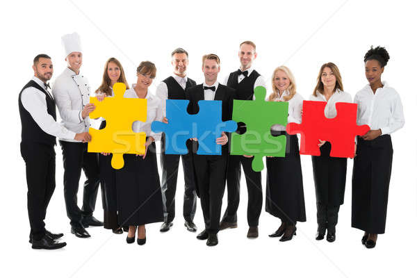 Confident Restaurant Staff Joining Jigsaw Pieces Stock photo © AndreyPopov