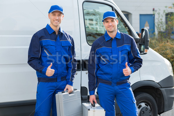 Happy Technicians Showing Thumbsup Against Truck Stock photo © AndreyPopov