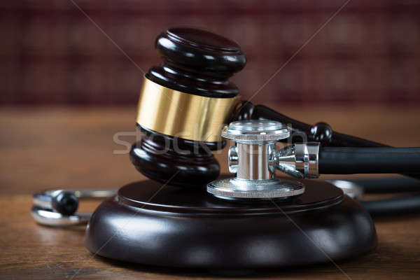 Stethoscope And Mallet In Courtroom Stock photo © AndreyPopov