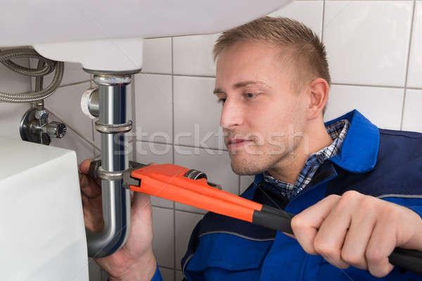 Stok fotoğraf: Erkek · tesisatçı · batmak · mutfak · genç
