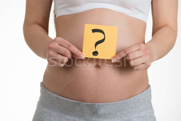 Pregnant Woman Holding Paper With Question Mark Stock photo © AndreyPopov